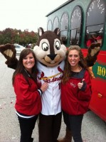 Kelley Rasco walking in the Victory Parade in St. Louis. She is shown here with the Cardinals new mascot, the Rally Squirrel.