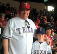 Chris & Carson Ray at WS Game 4 in Arlington.  Highlights of the game included Napoli's 2-run homer and Holland's 8 1/3 shutout innings pitched. Rangers won the game 4-0.