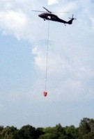 """Blackhawk helicopter, with """"pond bucket"""". (Photo by MLive reader.)"""