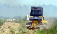 AFC fire-plows entering forest fire field..