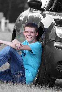 Brandon senior pic with car