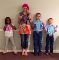 Pictured above are four 4-Her's who participated in Talks, Demonstrations & Fashion Revue. From left to right, E. McBroom, B. Lanthrip, E. Young, and B. Young.