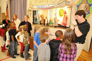 The Seark Concert Association's SMARTS (Schools Majoring in the Arts) program ensures that students in preschool through 12 grades have an opportunity to see live arts performances during the school year. Here, puppeteer Bob Walls, right, brings a show featuring marionettes to area elementary school children.