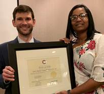 Porscha Preddy of Drew County Abstract and Title in Monticello, AR, accepts the 2019 Arkansas Young Title Person of the Year Award from Joshua Hite, Chairman of the Outstanding Young Leadership Committee.