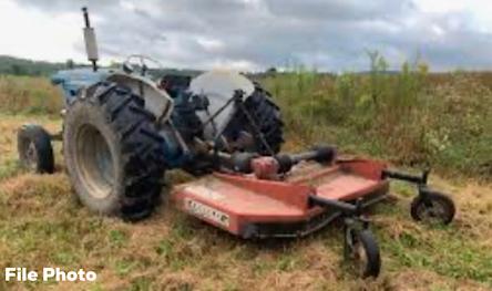 Tractor and Bush hog farm