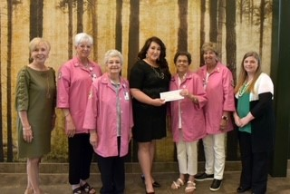 Drew Memorial Auxiliary Members (in pink) join UAM administrators to present their scholarship donation. L to R: Dr. Peggy Doss, UAM Chancellor; Edith Thurman and Shirley Kizer, Auxiliary members; Dr. Brandy Haley, UAM Dean of Nursing; Barbara Brown, Auxiliary President; Mellie Jo Owen, Auxiliary Member; and Ms. Crystal Halley, UAM Vice Chancellor for Academic Affairs